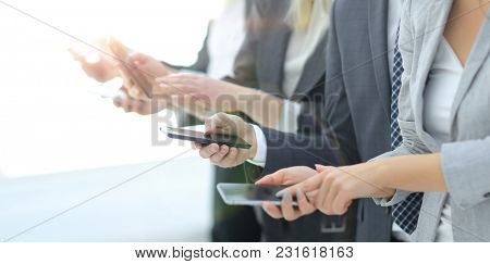 closeup.a group of employees with smartphones