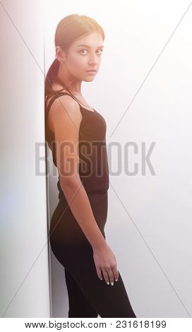 modern young woman leaning on wall