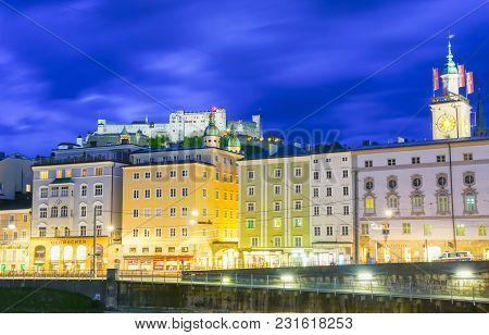 Salzburg, Austria - September 6 2017; Urban Night Light Glow Across Salzach River To Tourist Retail