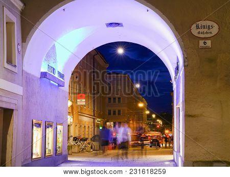 Salzburg, Austria - September 6 2017; Urban Night Lights Moving People And Cars Blurred Through Brig