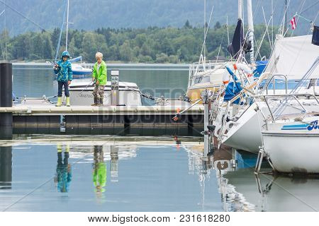 Mondsee Austria-september 6 2017; Boats Ready For Hire And Waiting Tied To Pier On Picturesque Europ