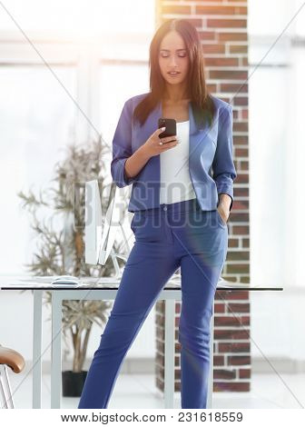 Full length of young businesswoman on Cell Phone