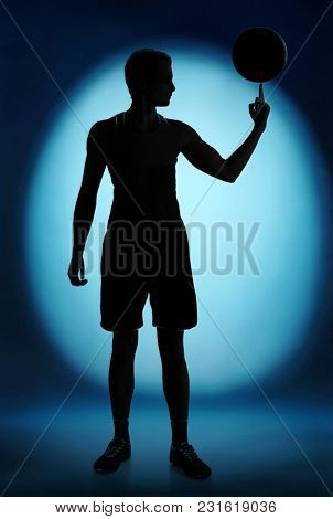Photo of basketball player silhouette