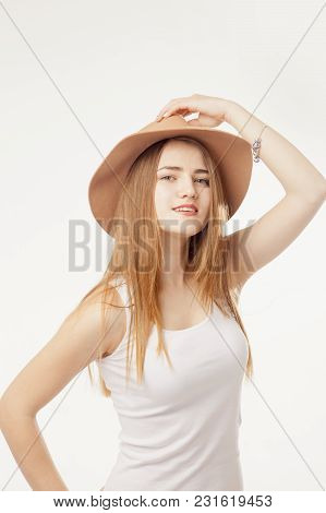 Portrait Of Beautiful Fashion Female Model In A Cowboy Hat As A Symbol Of Femininity And Beauty