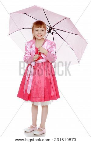A Beautiful Little Girl Is 6 Years Old, With A Short Bangs And A Big White Bow On Her Head. In A Red