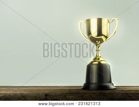 Champion Golden Trophy Placed On Wood Table .