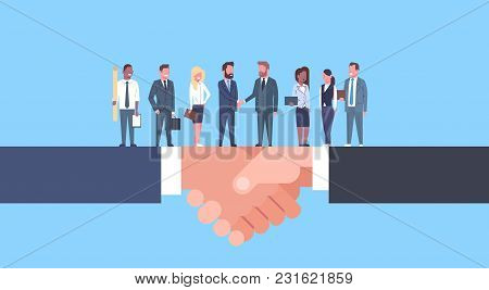 Two Businessmen Shaking Hands With Team Of Businesspeople, Business Agreement And Partnership Concep