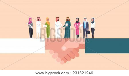 Arab Businessmen Shaking Hands With Team Of Muslim Businesspeople, Business Agreement And Partnershi