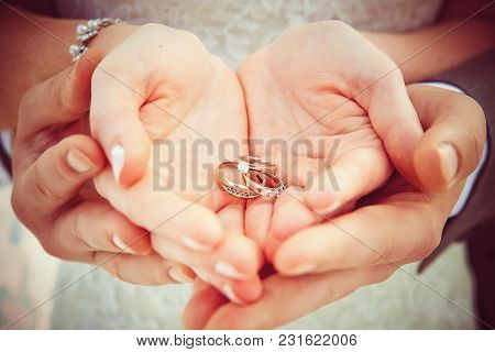 Hands And Rings On Wedding Bouquet Creative Picture