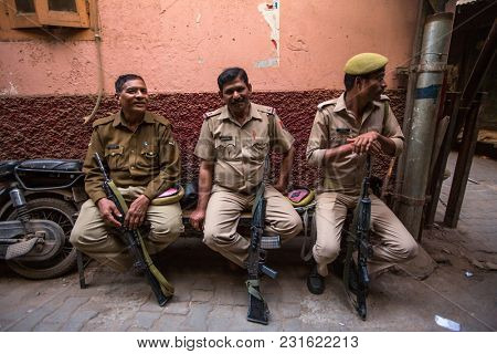 VARANASI, INDIA - MAR 16, 2018: Police patrol the streets of the city. According to legends, the city was founded by God Shiva about 5000 years ago.