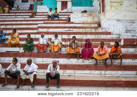 VARANASI, INDIA - MAR 15, 2018: Pilgrims expect ritual  Agni Pooja (Sanskrit: Worship of Fire) on Dashashwamedh Ghat - main and oldest ghat of Varanasi located on the Ganges.