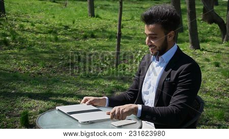 Person Using Laptop And Clicking Keyboard, Putting Hands Up, Close Computer And Goes Away. Boy Has B
