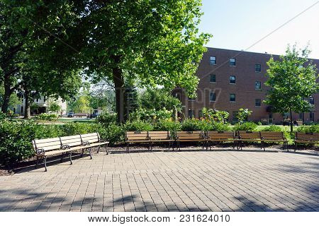 Joliet, Illinois / United States - July 27, 2017: People May Sit On Benches, On The Quad At The Univ