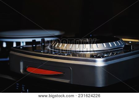 Music Mixing Equipment With Red Cd In A Dark Background