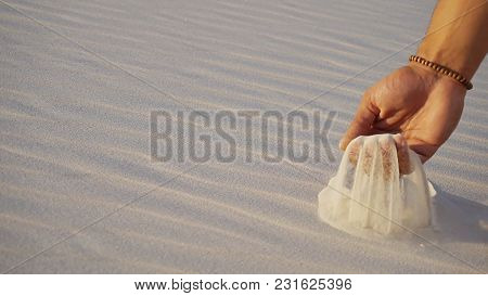 Close-up Of Face And Hands Of Young Muslim Man Arabian Sheikh Who Takes Sand Into Hand And Blows Sma