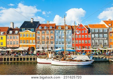 Copenhagen, Denmark - August, 13, 2017: Nyhavn Pier With Colorful Buildings And Boats In Copenhagen,
