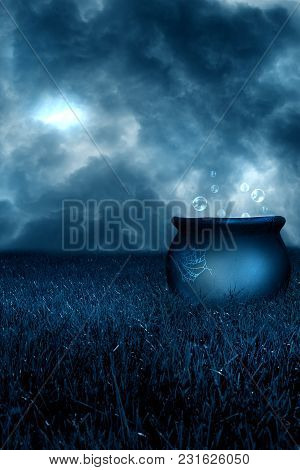 A Cauldron With Bubbles In A Stormy Field.