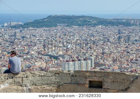Young Man Contemplates The City Of Barcelona From The Carmel On A Day Of June 2016