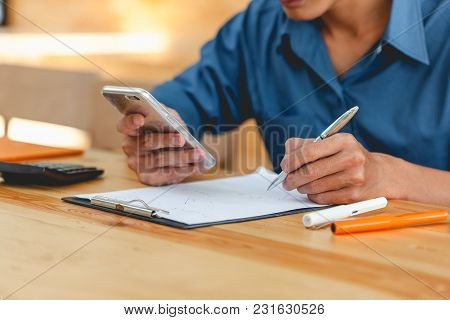 Man Hand Taking Notes Information And Searching For In The Mobile Smartphone