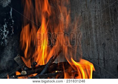 Fire Flames With Sparks On A Black Background, A Fire Burns In A Fireplace, Fire To Keep Warm.