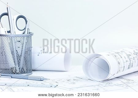 Blueprints Rolls, Architectural And Construction Plans With Drawing Tools On Desk