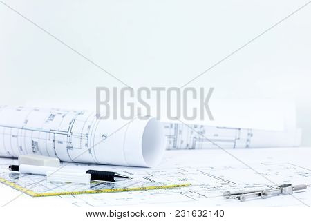 Engineering Plan, Drawing And Measuring Tools, Blueprint Rolls On Architect Workplace Desk