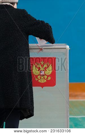Russian Presidential Election - A Woman Puts A Ballot Paper To Voting Box, Close Up