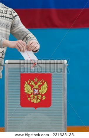 Russian Presidential Election - A Man Puts A Ballot Paper To Voting Box, Close Up