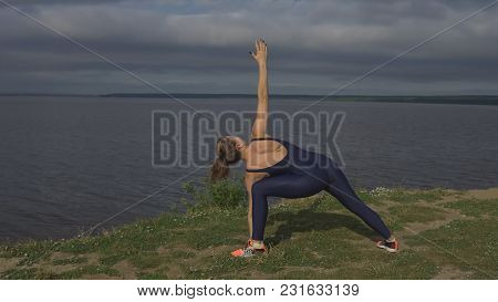 Woman In Blue Sportswear, Yogi Practice Outdoor.