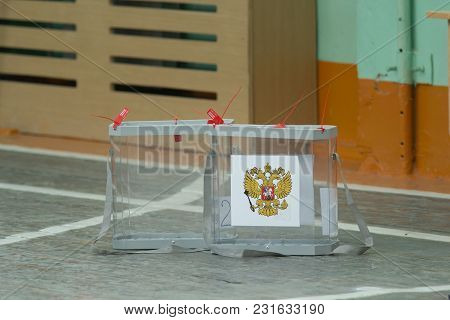 Russian Presidential Election - Empty Transparent Voting Box With Ballot Papers, Close Up