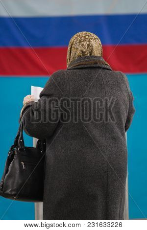Russian Presidential Election - Old Woman Puts A Ballot Paper To Voting Box, Close Up