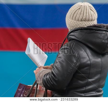 Russian Presidential Election - A Woman With Ballot Paper Ready Make Her Political Choice, Close Up