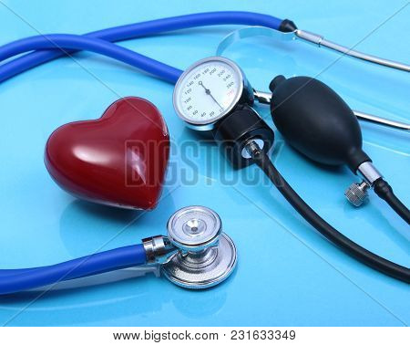 Stethoscope, Red Heart And Blood Pressure Meter On White Background. Selective Focus