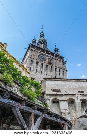 Sighisoara Clock Tower On A Sunny Day In Transylvania, Romania.