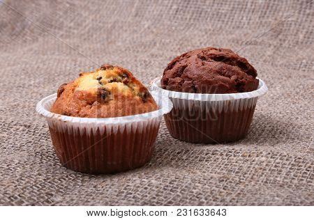 Fresh Homemade Muffins On Sackcloth Woven Texture Background. Top View