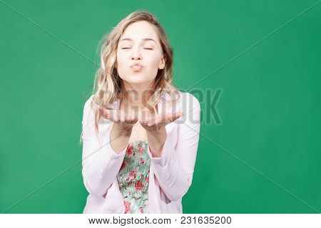 Pleasant Looking Caucasian Blonde Female Blows Kiss At Camera, Rounds Lips, Says Goodbye To Boyfrien