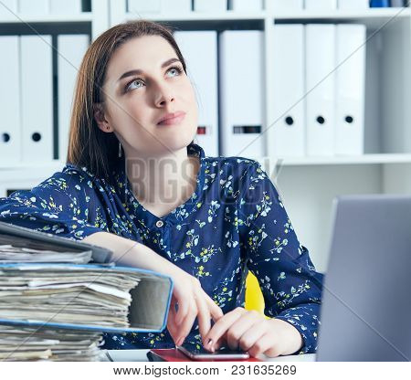 Businesswoman Or Secretary With Many Documents Folders Bills On Her Desk Taking Break, Relaxing At W
