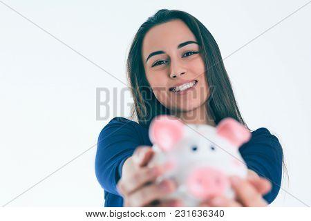 Surprised Beautiful Chef Woman Holding A Piggybank.