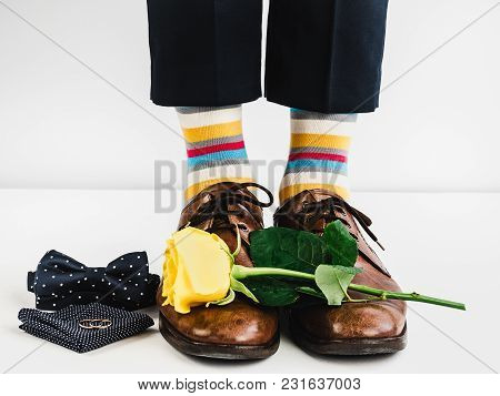 Wedding Rings, Yellow Rose, Bow Tie, Handkerchief, Bright, Funny Socks And Male Legs In Stylish Brow