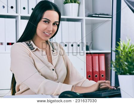 Focused Businesswoman Working At Desk In Creative Office. White Collar Worker At Workspace Exchange