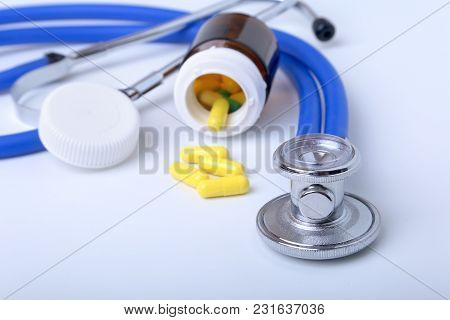 Asorted Pils And A Stethoscope On White Background.