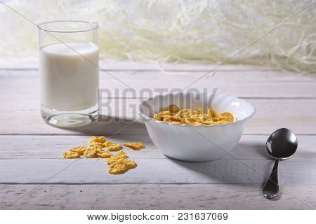 Corn Flakes Cereal In A Bowl And Glass With Milk. Morning Breakfast