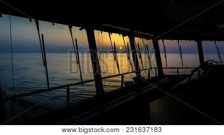 Sunset Through Ship's Windows