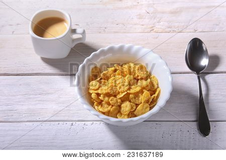 Corn Flakes Cereal In A Bowl And Cap With Espresso Coffee. Morning Breakfast