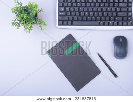 Modern Office Table With Keyboard, Phone, Notebook On White Background Top View Mock-up. Copy Space.