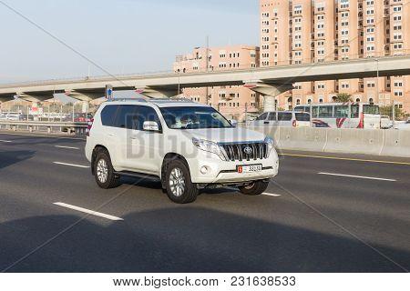 Dubai, Uae February 20, 2018: White Toyota Prado Rides On The Road
