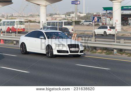 Dubai, Uae February 20, 2018: White Audi Rides On The Road