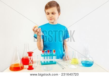 Young Boy Doing Chemical Experiments In The Laboratory