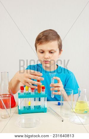 Young Smart Chemist Doing Chemical Experiments In The Laboratory