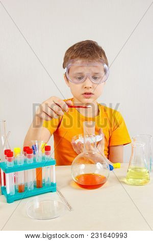 Little Chemist In Safety Goggles Studies Chemical Practice In The Laboratory